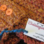 Crochet scarflette with tag