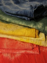 Red, yellow, green blue dyed fabrics