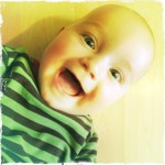 Sam at 8 months laughing