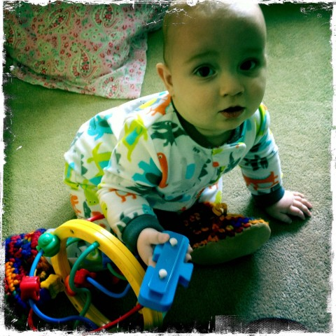 Sam playing with toys