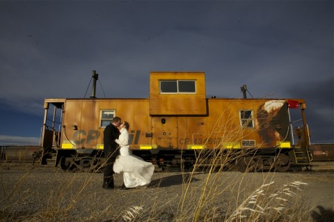 Sarah & Marcus kissing by train