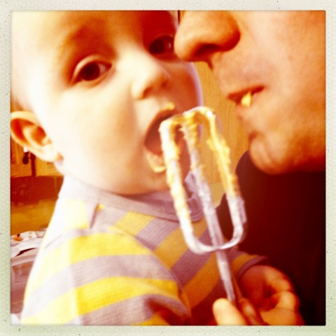 Sam and daddy eating icing