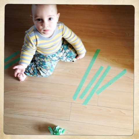 Sam playing with painter's tape 2