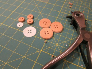 Leather buttons with their holes punched