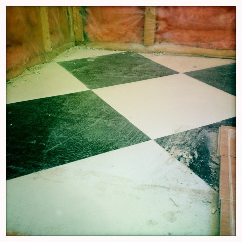 Old black and white checkered floor
