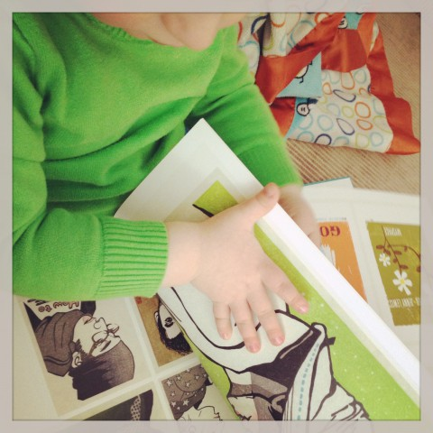 Sam is discovering all sorts of neat books on our shelves. Here he is enjoying one of our contemporary art illustration books.
