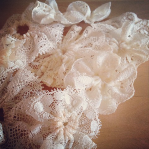 Evenings spent hand stitching piles of these lovely lace flowers (destined to be accents in some new products)