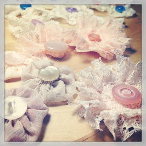 Lots of beautiful shabby chic inspired fabric button flowers for hair clip sets.
