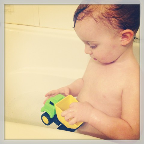 It's all about dump trucks and dinosaurs with this guy, even in the bathtub. Such a boy!