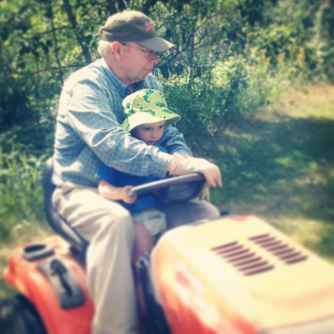 Sammy LOVED helping grandpa cut the grass out at the cabin.