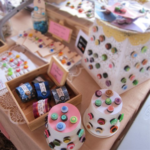 Fun Button Magnets and Love Cuff Bracelets. Making use of metal garbage pails & pots. Simple, but they work.