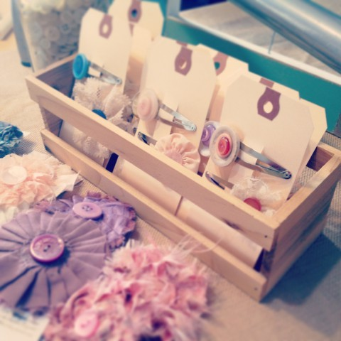 Fancy Button Hair Clip sets on cute cards (I've got a nice collection of wooden crates & boxes for display now).