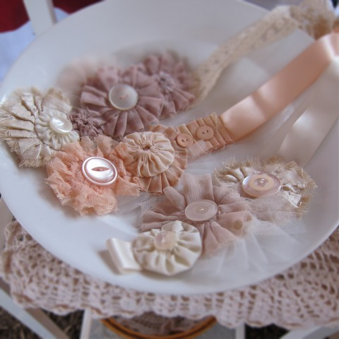 Pretty Shabby Chic Accessories that can be worn as a headband or as a belt with a simple dress (I'm always raiding our kitchen for things to use in my display, like this serving platter).